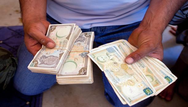دمشق وحدها تدفع أكثر من 19 مليار… هل تعلم أن النظام يتقاضى راتباً شهرياً من كل أسرة؟