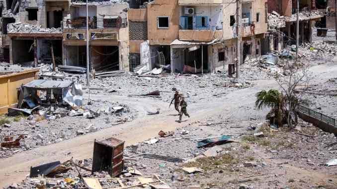 مجهولون يطلقون النار على مقر للنظام وحاجز لقسد بديرالزور.. وسقوط قتلى وجرحى