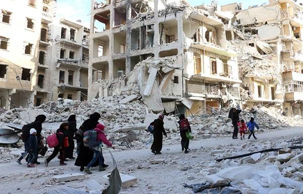 مرسوم جديد للأسد يسمح بإزالة أنقاض الأبنية المتضررة