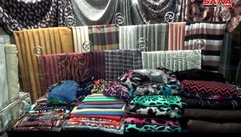 دمشق… كورونا تواصل منع عمل محال الألبسة والخياطة