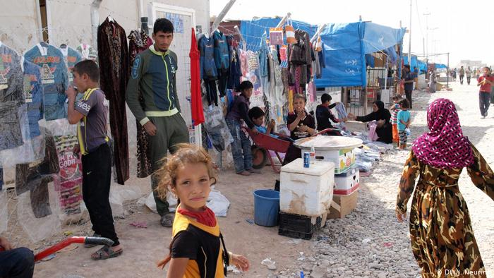 """بين القوى الكردية و""""الحشد الشعبي"""": الصراع بين الفصائل الإيزيدية العراقية يعمّق جراح """"سنجار"""""""